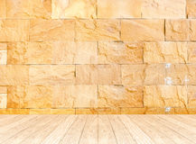 Empty perspective room with sand stone wall and wooden plank flo Stock Photography