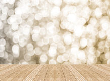 Empty perspective room with sparkling bokeh wall and wooden plan stock photography