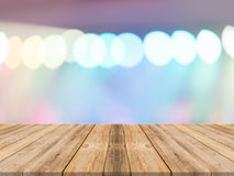 Empty perspective room with sparkling bokeh wall and wooden plank floor. Royalty Free Stock Images
