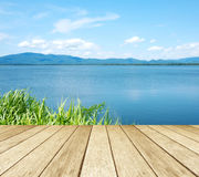 Empty perspective wood over lake and blue sky background, spring Stock Image
