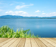 Empty perspective wood over lake and blue sky background, spring Stock Photos