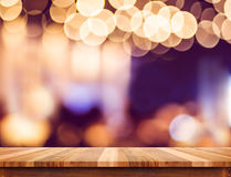 Empty perspective wood plank table top with abstract bokeh light Royalty Free Stock Photos