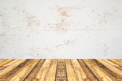 Empty perspective wood plank table top with old cement wall blackground royalty free stock photo