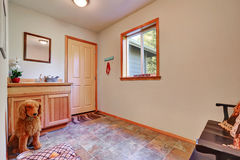 Empty pet room with vanity cabinet and tile flooring Stock Images