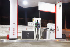 Empty petrol station with illumination and guns at winter Royalty Free Stock Photography