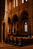 Empty Pews. Casting shadows in the cathedral Stock Images