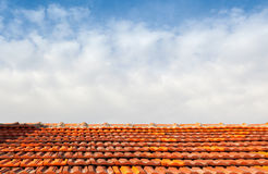 Empty photo background with red tile roof and sky Stock Photos
