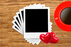 Empty photo cards, coffee cup and red hearts on wood Stock Photos