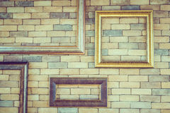 Empty photo frame on brick wall textures Royalty Free Stock Images
