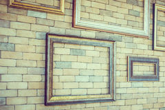Empty photo frame on brick wall textures Stock Images