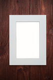 Empty photo frame on brown wooden desk Stock Photography