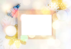 Empty photo frame with christmas tree toy, white and gold snowfl Stock Photo
