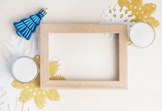 Empty photo frame with christmas tree toy, white and gold snowfl Stock Images