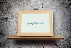 Empty photo frame on Grungy gray concrete wall with cracks hole Royalty Free Stock Photography