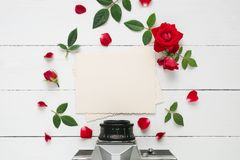 Empty photo frame for inside, retro camera and rose flowers. Retro empty photo frame for the inside, retro camera  and red rose flowers on white background. Flat Royalty Free Stock Photography