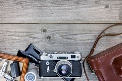 Empty photo frame, old camera with leather case and negative fil Royalty Free Stock Photos