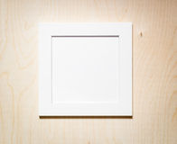 Empty photo frame on a wooden background Stock Image