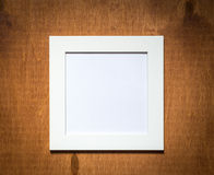 Empty photo frame on a wooden background Stock Photography