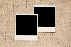 Empty photo frames on linen texture Royalty Free Stock Photos