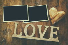 empty photo frames next word LOVE from wooden letters Stock Photo