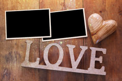 empty photo frames next word LOVE from wooden letters Royalty Free Stock Photos