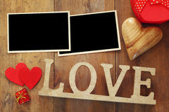 empty photo frames next word LOVE from wooden letters Stock Photos
