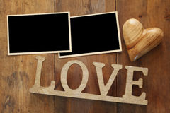 empty photo frames next word LOVE from wooden letters Royalty Free Stock Image