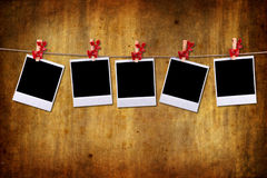 Empty photo frames over grunge background