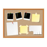 Empty photo frames, paper notes and yellow stickers attached to Stock Images