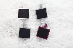 Empty photo frames on snow Royalty Free Stock Photos