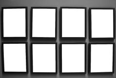 Empty photo frames on wall Stock Photo