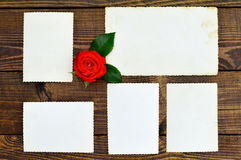 Empty photo frames. On wooden background royalty free stock photos
