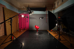 Empty photo studio with lighting equipment Royalty Free Stock Photos