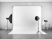 Empty photo studio with lighting equipment Stock Photos