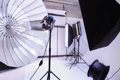 Empty photo studio with modern lighting equipment Stock Image