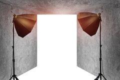Empty photo studio in old grunge room. And two black softbox lighting royalty free stock photography