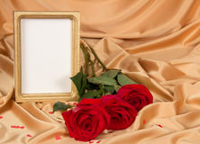 Empty photoframe with roses Royalty Free Stock Photos
