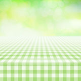 Empty picnic gingham tablecloth, green background Stock Photography