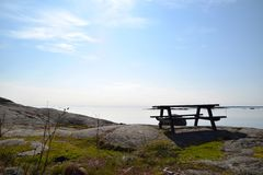 Picnic table in the Swedish archipelago stock photography