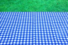 Empty Picnic Table With Blue White Tablecloth Background Stock Photos