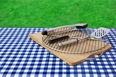 Empty Picnic Table, Checkered Tablecloth,  Grid, BBQ Grill Tools Stock Images