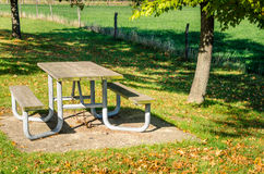 Empty Picnic Table on a Sunny Day. Empty Picnic Table in a Recreation Area on a Sunny Fall Day Stock Photos
