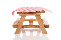 Empty picnic table with tablecloth Royalty Free Stock Photos
