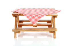 Empty picnic table with tablecloth Stock Images