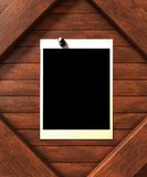 Empty picture. On wood background. Additional PNG format available where the black rectangle on the picture frame is a mask and a personalized photo can be Stock Images