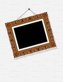 Empty picture in decorative frame on wall Stock Photos