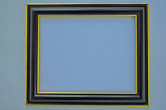 Empty Picture Frame. Blue Picture Frame hanging on wall Stock Photography