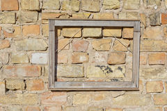 Empty picture frame on brick wall stock photos