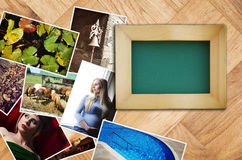 Empty picture frame with a bunch of photographs Royalty Free Stock Photos