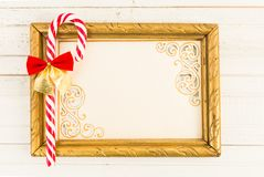 Empty picture frame with Christmas cane candy Stock Images